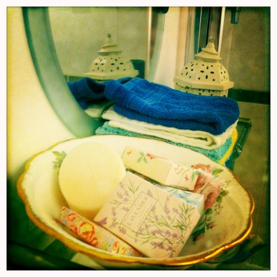 The different items on the Bathroom shelf work well with the vintage and coastal themes.