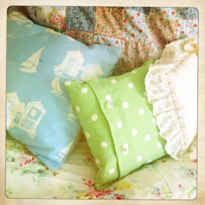 These pretty cushions match the colours in the 'Spring Bouquet' duvet cover.