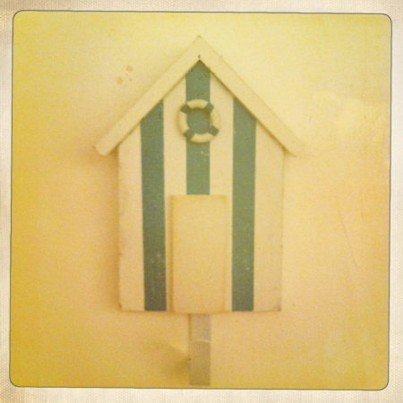 This old-fashioned beach hut peg ties in well with the coastal feel in the bathroom.