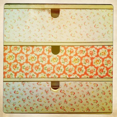 Complementary floral paper pretties up these wooden drawers.