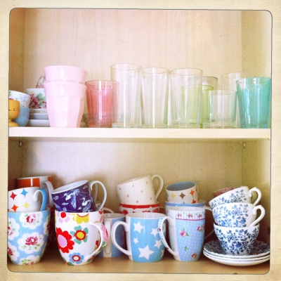 A colourful collection of pretty cups, mugs and glasses.