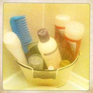 This old enamel bucket is a useful storage option for a range of toiletries.