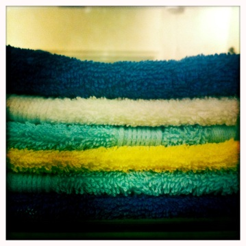 Layered flannels in royal blue, turquoise, yellow and white continue the beach theme.