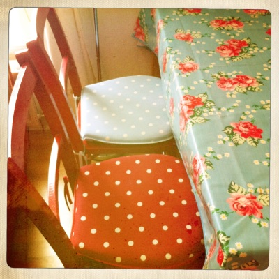 Pretty polka-dot cushion covers in complementary colours.