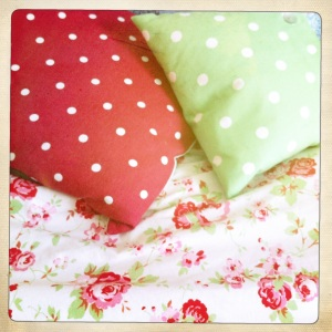 These Cath Kidston spotted cushions draw out key colours in the 'Rosali' duvet cover.