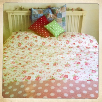 This gorgeous Cath Kidston duvet cover ('Rosali') has red, pink and green flowers on one side and red and green gingham check on the reverse.