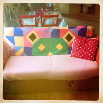 Change the appearance of sofas and chairs using colourful blankets and throws.