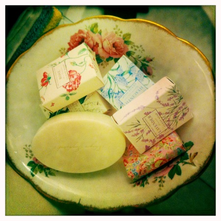 A gorgeous vintage bowl is repurposed as a soap dish.